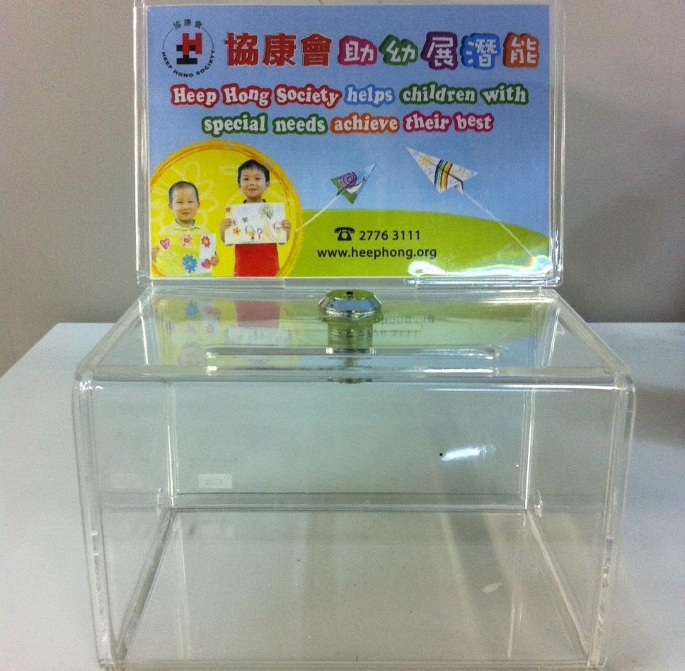 "Small donation box measures 6""(L) x 4""(W) x 3.5""(H)"